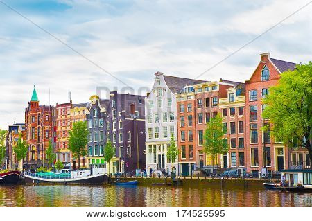 Beautiful view of the Colorful okd facades historic buildings in Amsterdam. Amsterdam is the capital of the Netherlands. Amazing summer cityscape. Horizontal Image