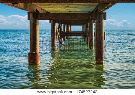 Sea Horizon With Fishing Pier On Foreground