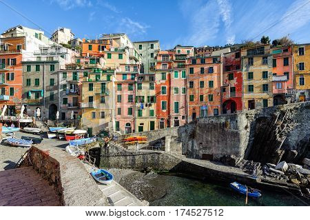 RIOMAGGIORE, ITALY - DECEMBER 2016: View on architecture of Riomaggiore town. Riomaggiore is one of the most popular town in Cinque Terre National park, Italy