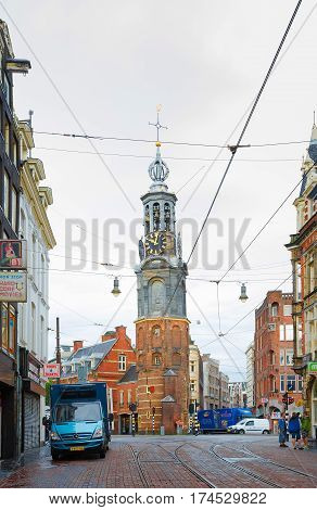 AMSTERDAM. NETHERLANDS - JUNE 2016 Beautiful cityscape with ancient architecture of Amsterdam. View of the Mint square with the Historical tower Munttoren. Netherlands. Vertical Image