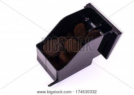 Pressed coffee waste container on white. Studio Photo