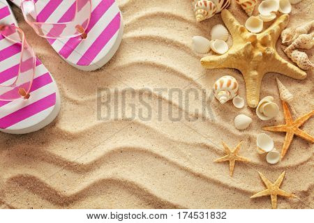 summer flip-flops on the sand beach. summer frame background