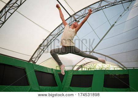 MOSCOW, RUSSIA - AUG 29, 2016: Happy girl  jumps on trampoline in center Just Jump in Sokolniki park. Trampoline Arena is suitable for both adults and children athletes and fans.