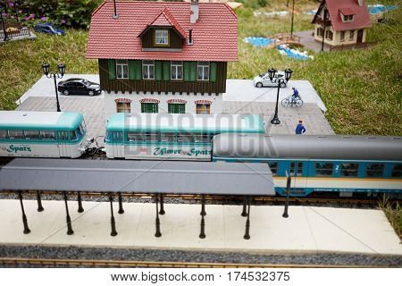 MOSCOW, RUSSIA - JUN 26, 2015: Layout of old railway station with rails, Ulmer Spatz trains and buildings in Sokolniki park during festival Gardens and People.