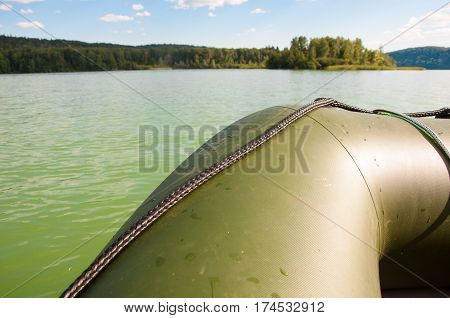 Closeup of a boat on the lake with trees on background