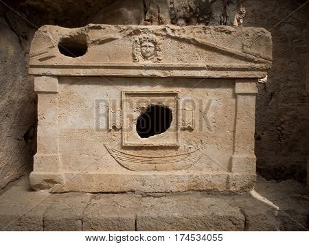 Robbed lycian sarcophagus in Olympos archeological site Turkey