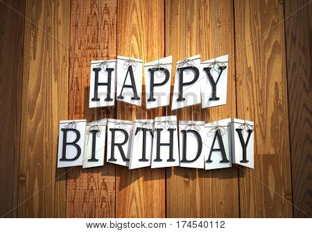 3D rendering of  hanging white shapes with raised letters forming the words Happy Birthday against a wooden background
