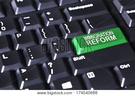 Picture of computer keyboard with text of immigration reform on the green button