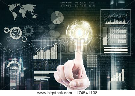 Hand of businessman touching a gold button with financial business on the virtual screen