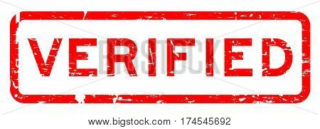 Grunge red verified square rubber stamp on white background