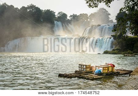 View At Detian Waterfalls With Bamboo Raft On Water