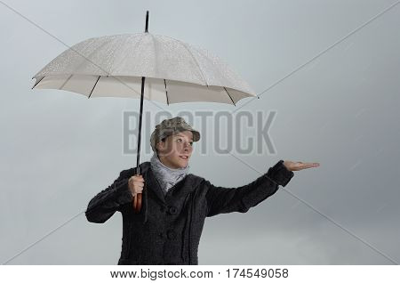 Woman with umbrella outdoor in rainy weather