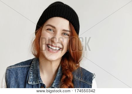 People And Lifestyle Concept. Portrait Of Attractive Girl With Braid Looking At Camera With Joyful C
