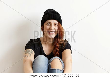 Charismatic Friendly Caucasian Student Girl Relaxing Indoors, Having Carefree Look, Smiling Cheerful