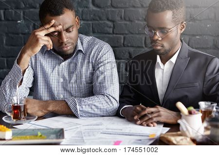 Candid Shot Of Two Handsome African-american Business Partners Having Frustrated Looks, Focused On W