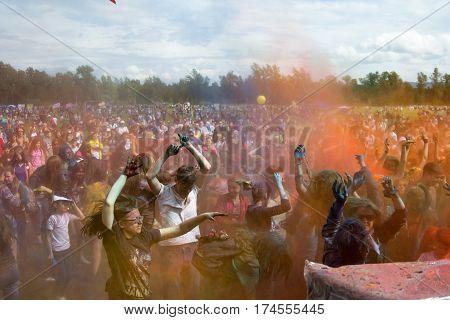 People dancing after powder buttle. KRASNOYARSK RUSSIA - JUNE 2015: People celebrate Holi-like part of festival Green