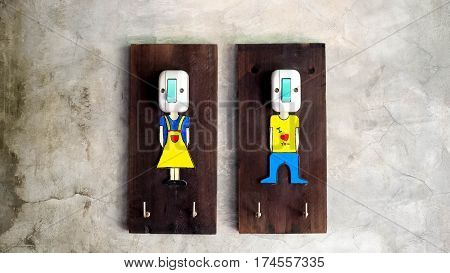 The switch for turning on-off the lights. Symbol of man and woman