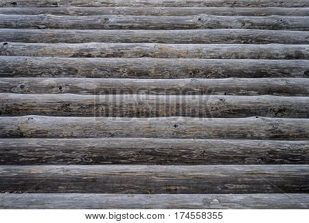 Texture of unpainted natural wooden logs surface