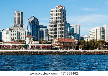 SAN DIEGO, CALIFORNIA - MARCH 2, 2017:  View from the ocean of Seaport Village restaurant and shopping complex, with the downtown San Diego Skyline.