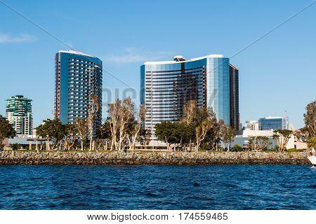 SAN DIEGO, CALIFORNIA - MARCH 2, 2017:  Embarcadero Marina Park North and surrounding hotels on San Diego Bay.