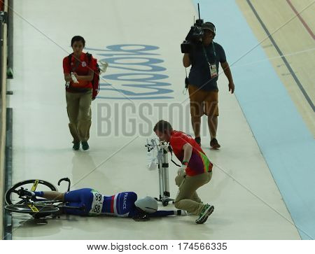 RIO DE JANEIRO, BRAZIL - AUGUST 13, 2016: Cyclist Virginie Cueff of France crashes during Rio 2016 Olympics women's keirin first round heat 2 at the Rio Olympic Velodrome