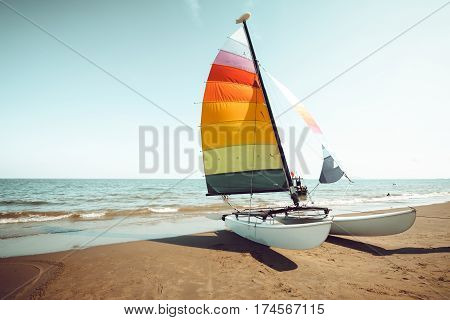 Vintage colorful sailboat on tropical beach in summer. retro color tone effect