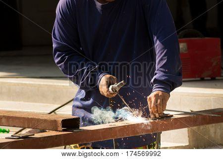 Male Worker or Welder Welding Steel or Metal at Construction Site Workshop Project