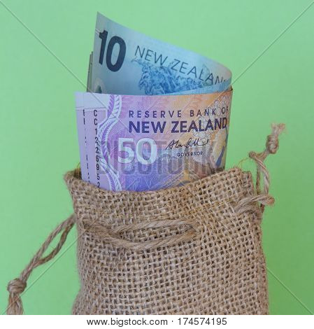 New Zealand dollars in a hessian bag (square)