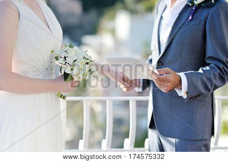 Groom's speech to the bride during wedding ceremony couple holding hands