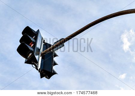 Traffic light against a clear blue sky.
