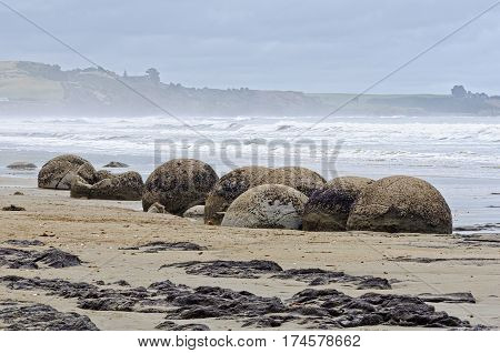Moeraki Boulders are large, spherical boulders lying on the Koekohe Beach at Moeraki on the South Island of New Zealand