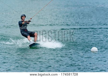 Young Woman Wakeboarding On Lake