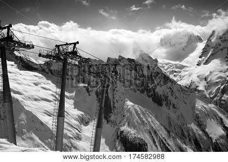 Black And White View On Cable Car At Ski Resort And Mountains