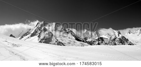 Black And White Panorama On Ski Slope And Winter Mountains