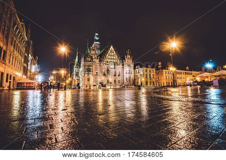 Wroclaw, Silesia, Poland - September, 19th, 2016. Market Square by night illumination. Wroclaw Town Hall, built in Gothic architecture style, one of the main landmarks and attractions in city.