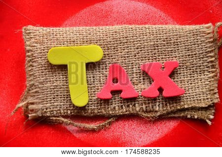word tax on a  abstract colorful background