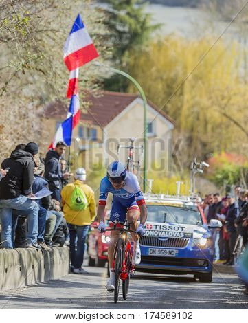 Conflans-Sainte-HonorineFrance-March 62016: The Lithuanian cyclist Ignatas Konovalovas of FDJ Team riding during the prologue stage of Paris-Nice 2016.