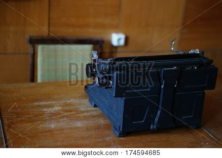 Photography of a antique typewriter on a wooden old table