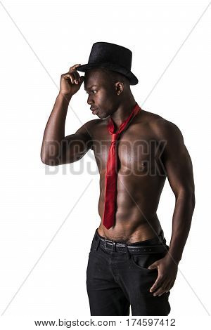 Attractive black young muscle man naked, wearing only pants and red necktie, isolated on white