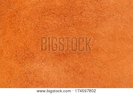 Texture of genuine leather close-up, cowhide, orange. For natural, artisan backgrounds, substrate composition use, vintage design