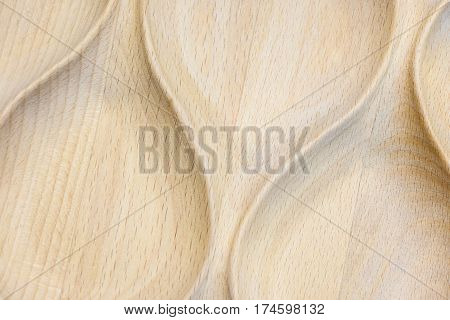 Wooden texture. The smooth convex curved lines are carved from wood.