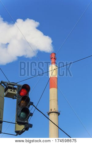 industrial chimney and red light