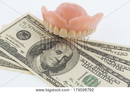 dentures and dollar bills