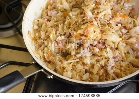 Close-up of skillet with braised cabbage with bacon