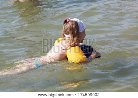 Little Girl Plays In The Sea