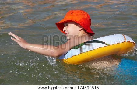 Boy played in the sea with rubber ring. Childhood