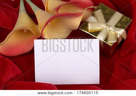 Red And Yellow Calla Lily Flowers Golden Gift Box With Yellow Ribbon On Red Fabric Background Card F
