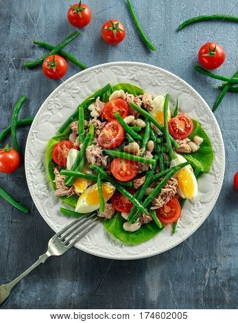 Fresh Tuna Green Bean salad with eggs, tomatoes, beans on white plate. concept healthy food.
