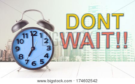 Dont wait with clock on city background concept