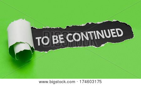 Torn green paper revealing the words to be continued